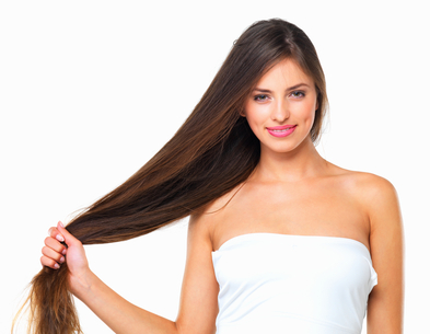 Closeup of lovely young woman flaunting her healthy hair on white background